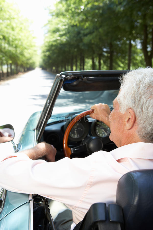 Senior man in sports car royalty free stock photography