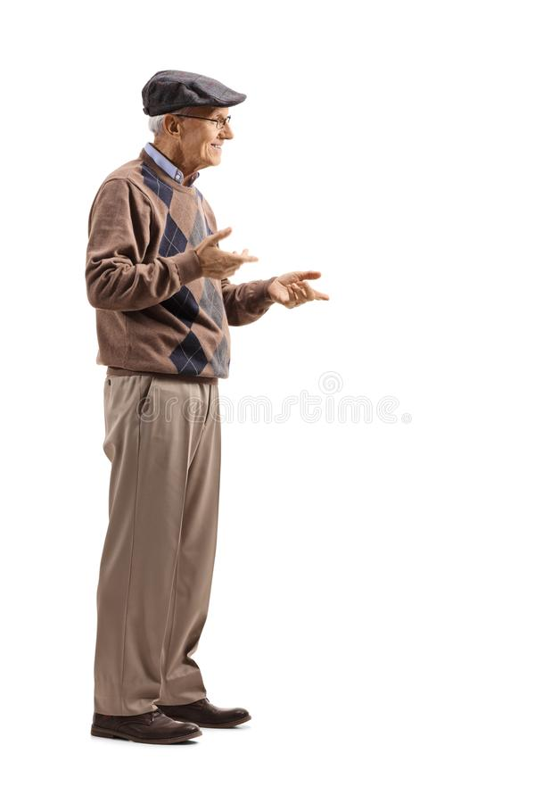 Senior man standing alone and gesticulating conversation royalty free stock image