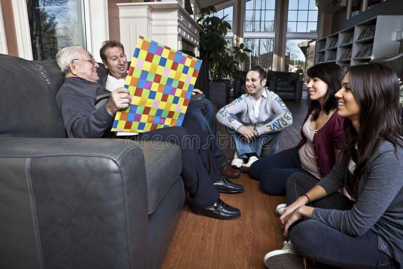 Senior man story telling to his family.  stock photo