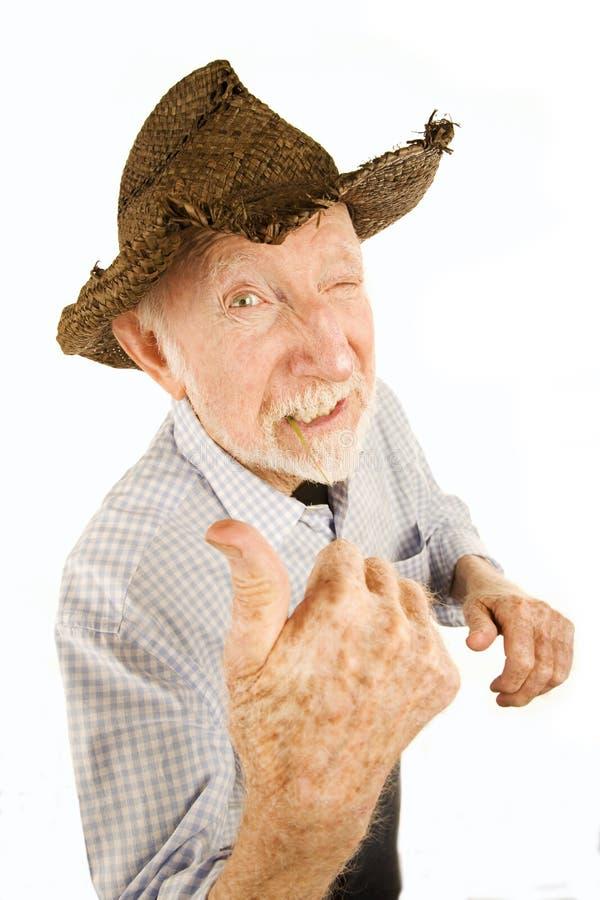 Senior man in straw hat stock images