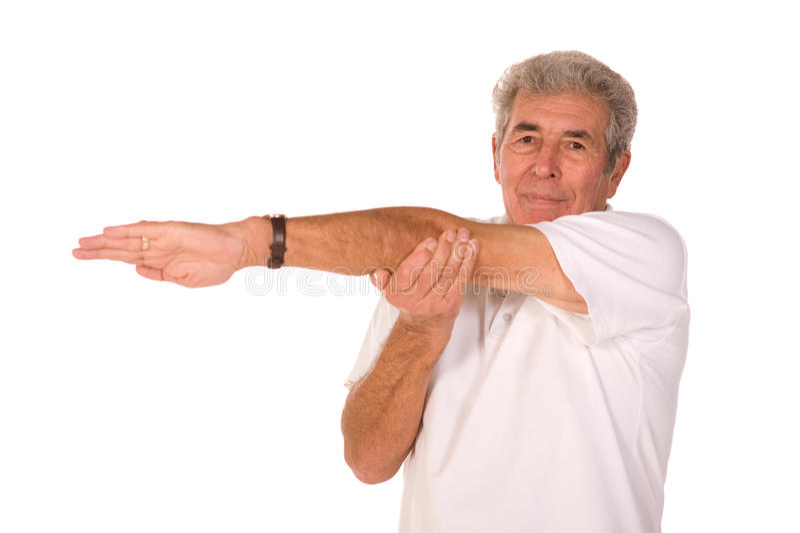 Senior man stretching royalty free stock images