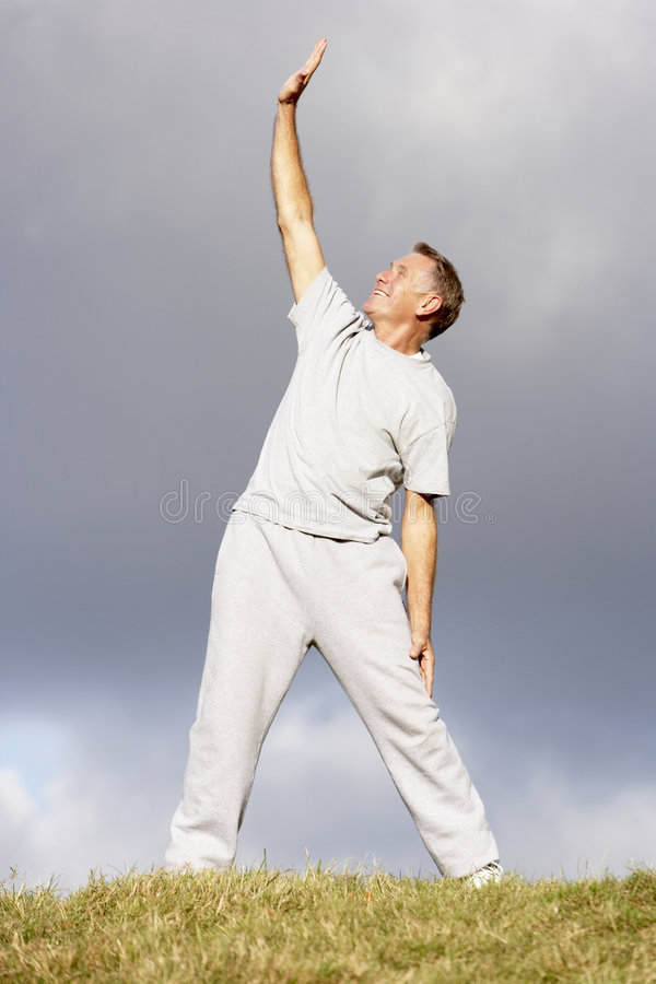 Senior Man Stretching In The Park royalty free stock photos