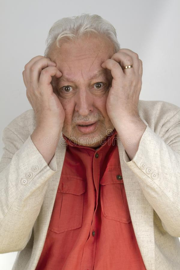 Senior man with strong headache stock photo