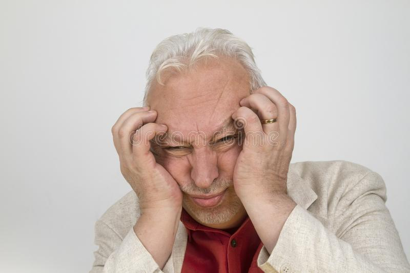 Senior man with strong headache royalty free stock photos