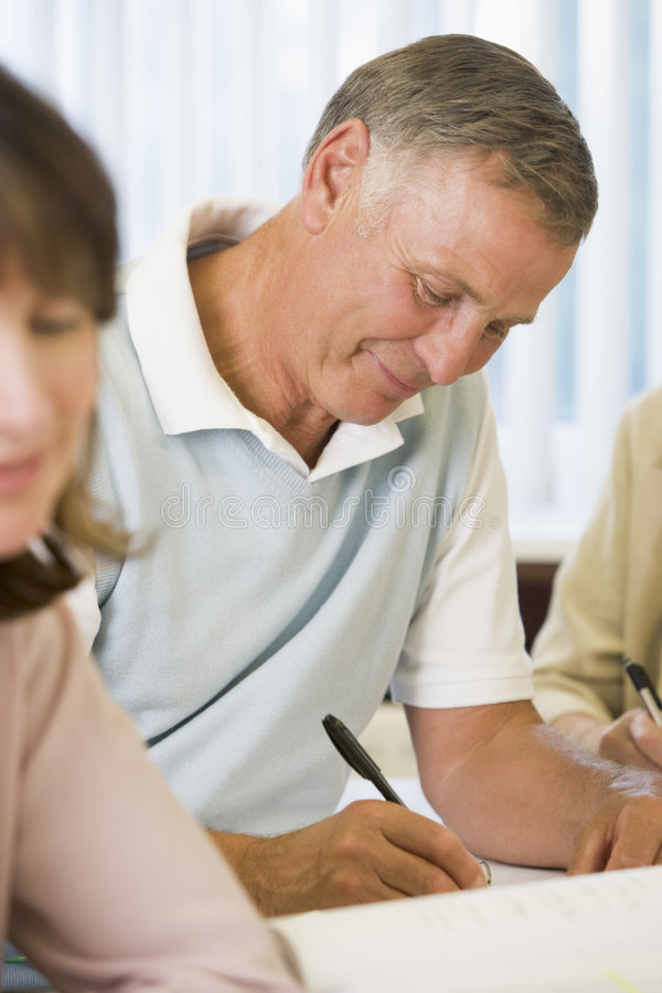 Download Senior Man Studying With Other Students Stock Image - Image: 6080533