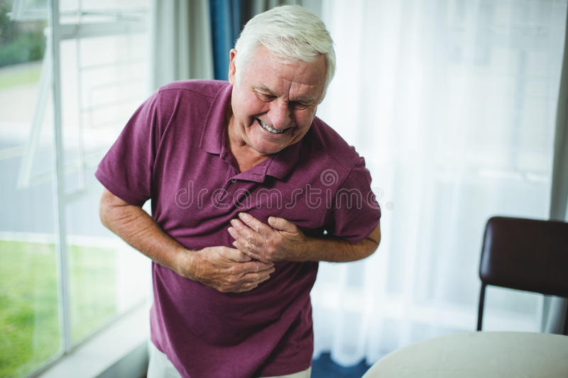Senior man suffering from chest pain royalty free stock image