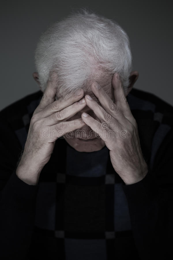Senior man suffering from deep depression royalty free stock photography