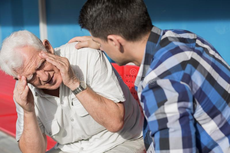 Senior man suffering from dizziness royalty free stock photography