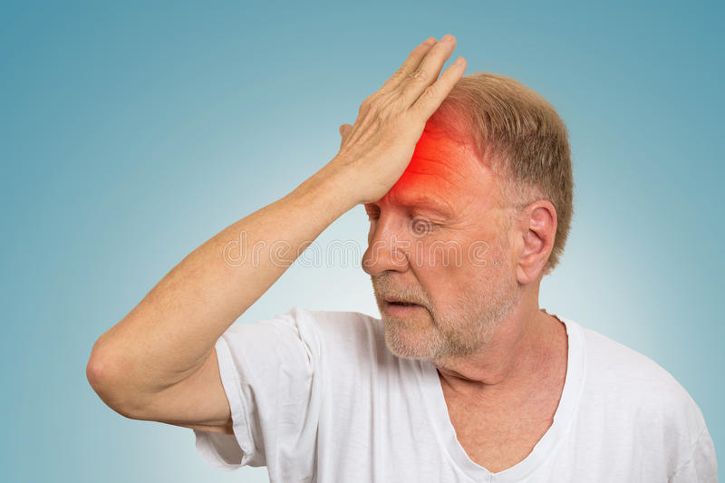 Senior man suffering from headache hands on head royalty free stock image