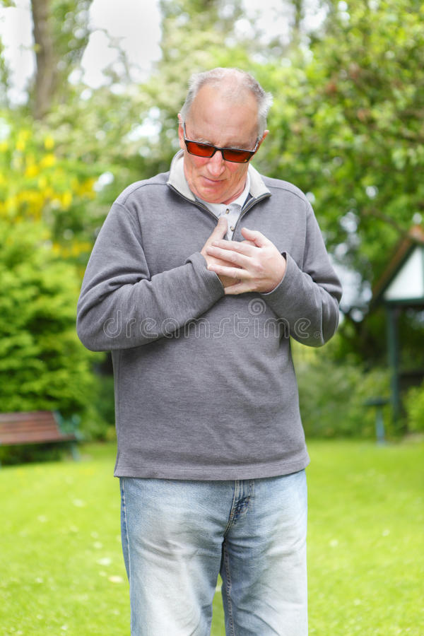 Senior Man Suffering Heart Attack Royalty Free Stock Image
