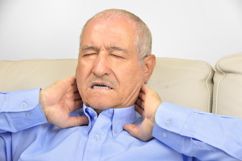 Senior man with neck pain stock images