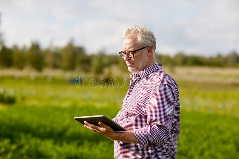 Senior man with tablet pc computer at county. Technology, old age and people concept - senior man with tablet pc computer at county royalty free stock photo
