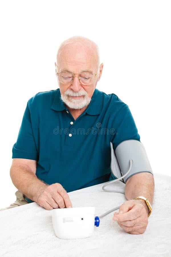 Senior Man Takes His Blood Pressure stock image
