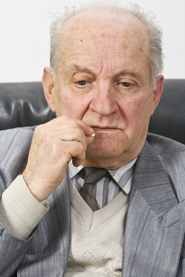 Senior Man Taking Medication Stock Photo