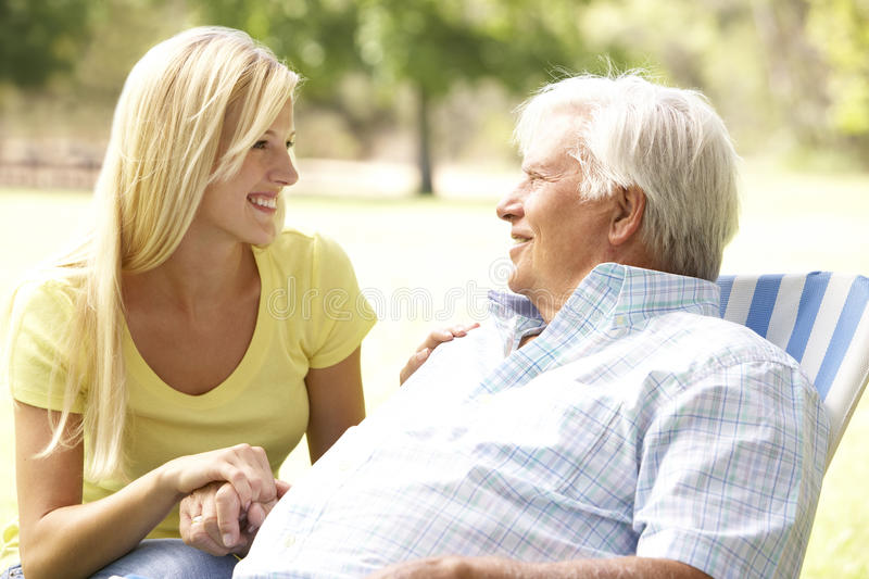 Senior Man Talking To Adult Daughter royalty free stock image