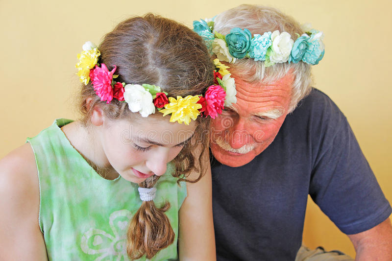 Senior man and teenage girl royalty free stock image
