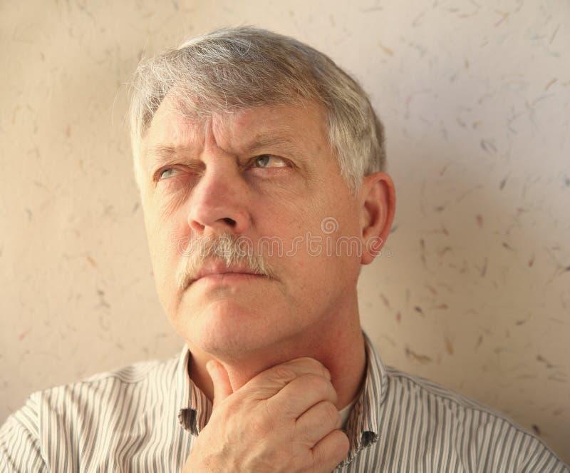 Senior man with throat pain royalty free stock image