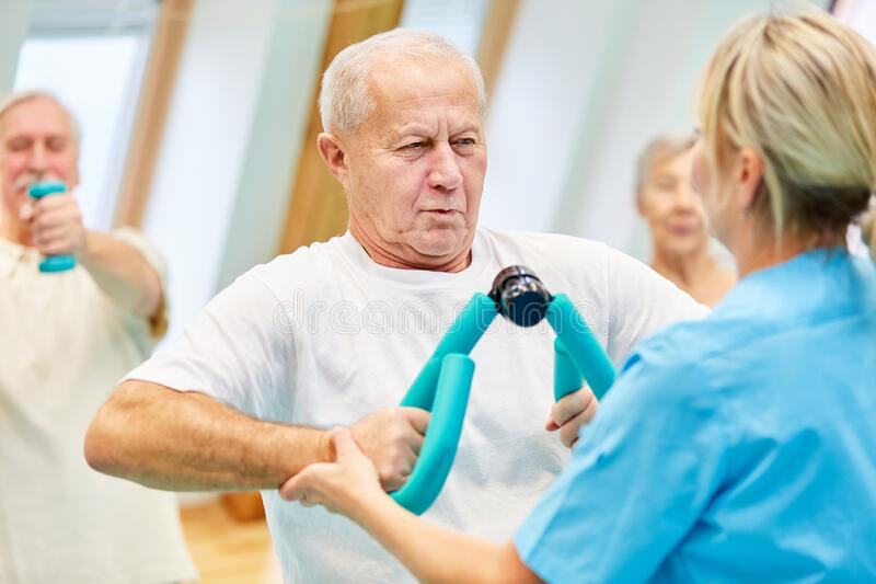 Senior man trains the chest muscles stock image