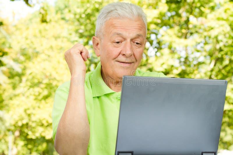 Download Senior Man Using Laptop Royalty Free Stock Image - Image: 21388366