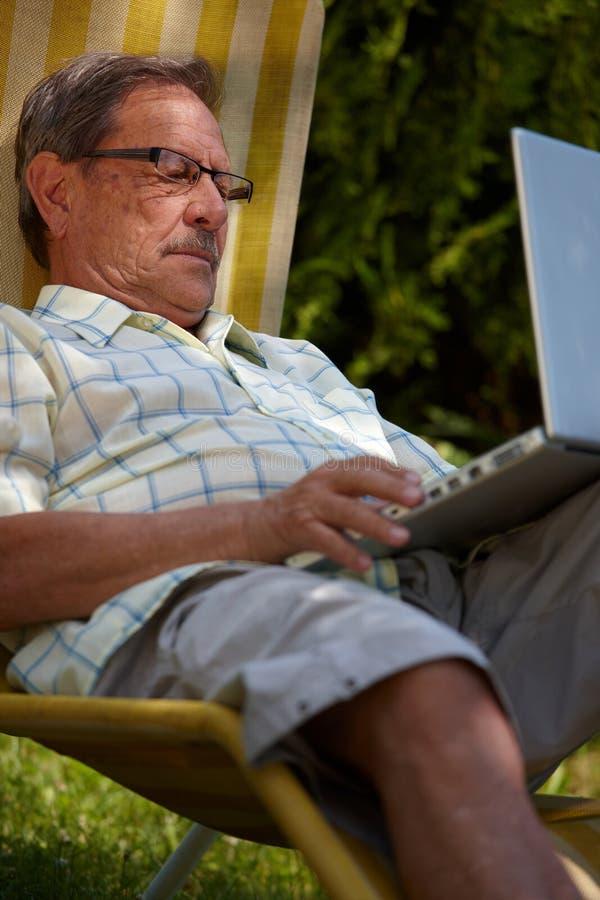 Download Senior Man Using Laptop Outdoor Stock Photo - Image: 7976278