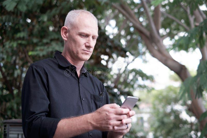 Senior Man Using Smartphone stock image