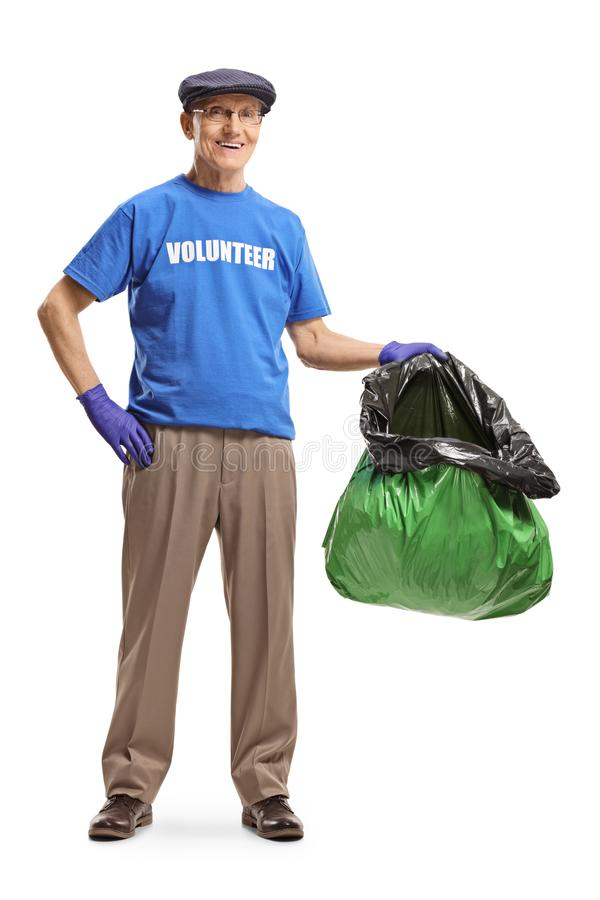 Senior man volunteering and holding a plastic bag stock photography