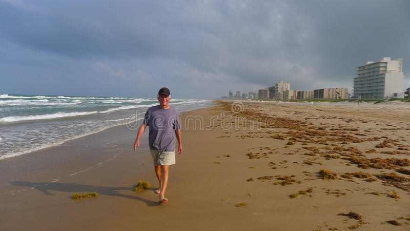 Senior Man Walking On Beach Stock Photo