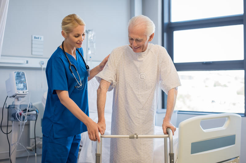 Senior man walking with walker stock photography