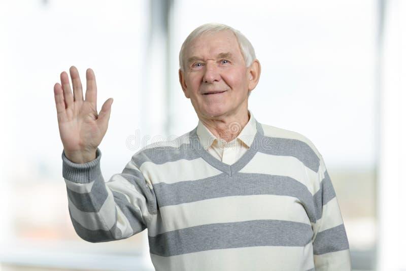 senior-man-waving-hand-happily-senior-ma