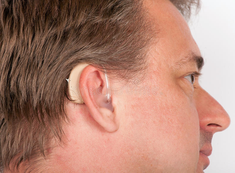 Senior man wearing hearing aid royalty free stock photography