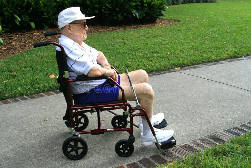 Senior man in wheel chair stock image