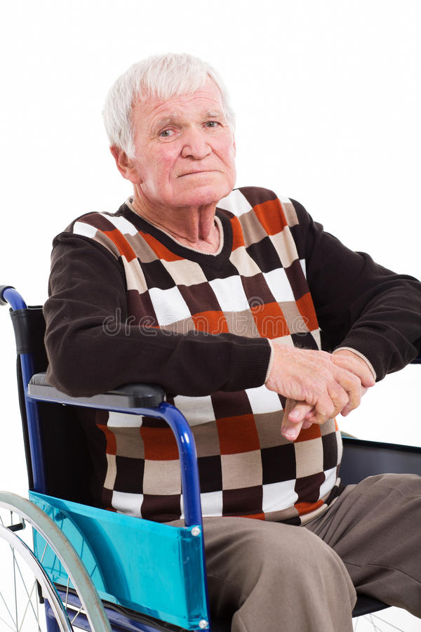 Senior man wheel chair. Close up portrait of disabled senior man sitting on wheel chair on white background stock images