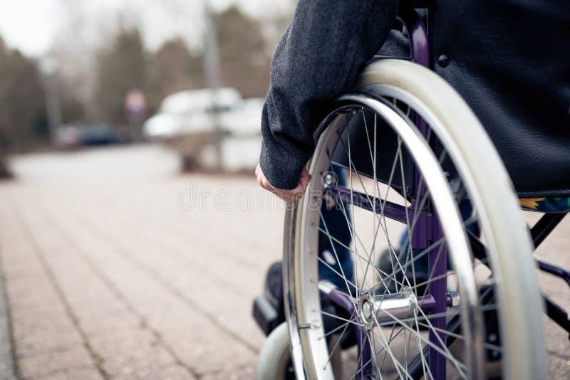 Senior Man In Wheelchair. Outdoors shot of a senior man sitting in wheelchair