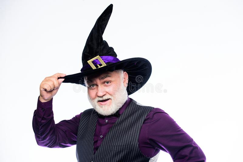 Senior man white beard celebrate Halloween. Magician witcher old man. Magic concept. Experienced and wise. Magic spell stock photo