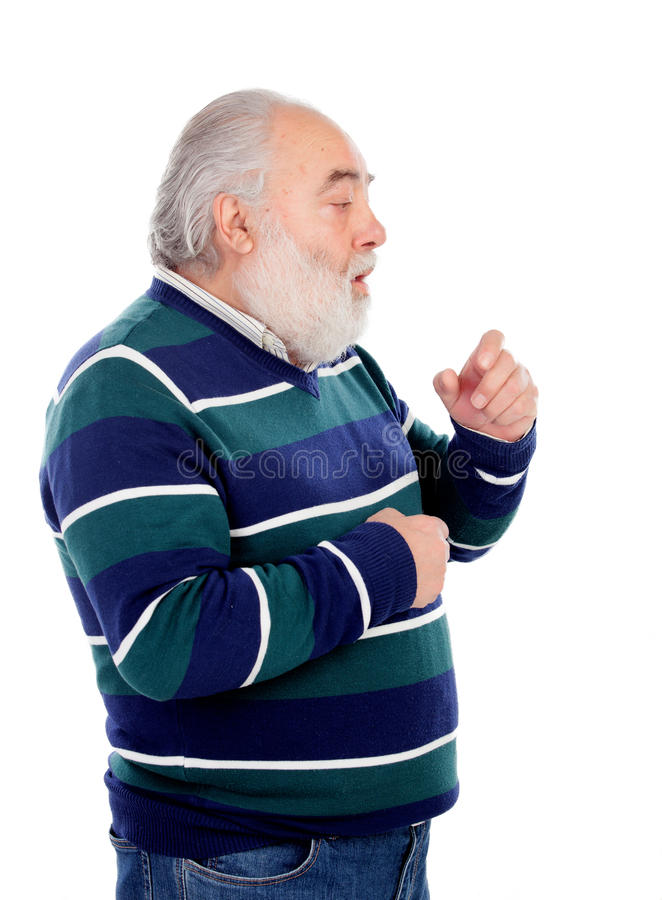 Senior man with white beard coughing royalty free stock image