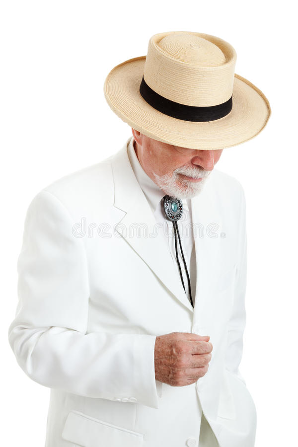 Senior Man in White Suit and Panama Hat stock photo