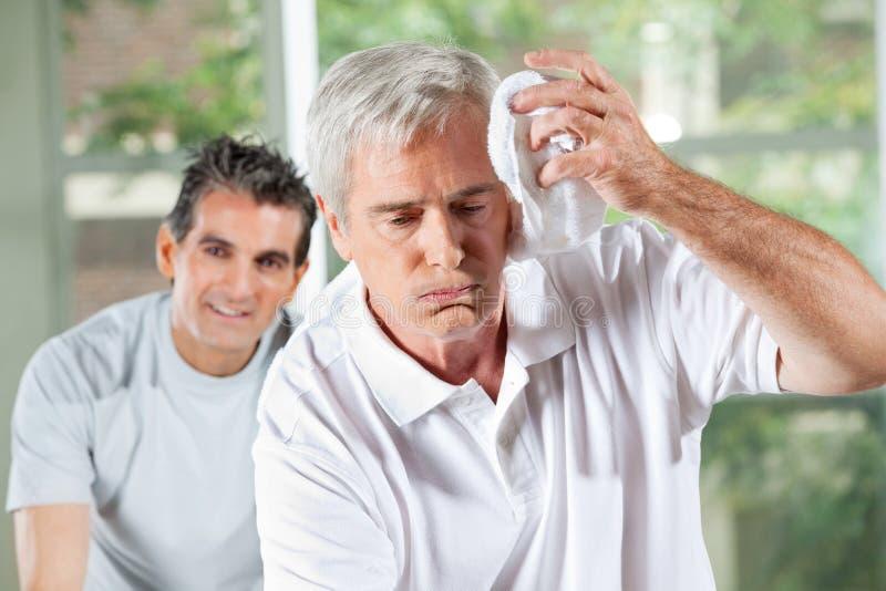 Download Senior Man Wiping Sweat Of His Stock Image - Image: 23996489