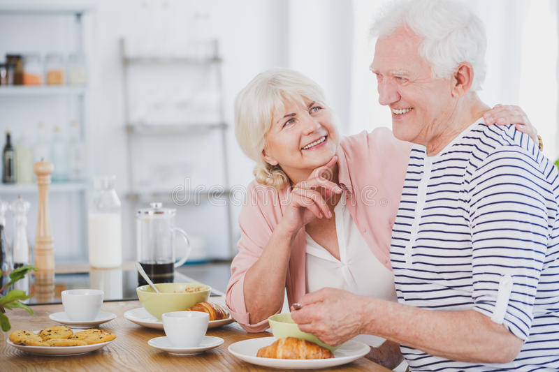 Senior man and woman at breakfast stock images