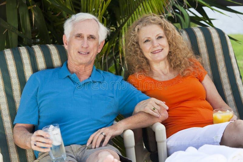 Senior Man And Woman Couple Enjoying Drinks Stock Photo