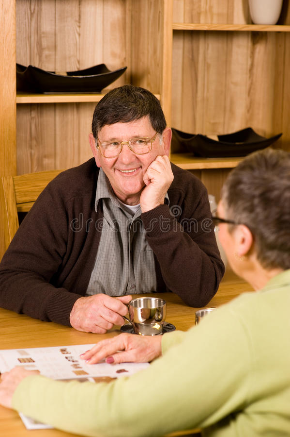 Download Senior Man And Woman Couple Looking At Brochure Stock Image - Image: 12886837