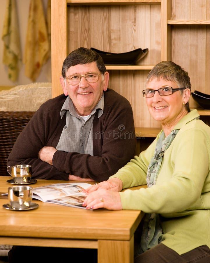 Download Senior Man And Woman Couple Looking At Brochure Royalty Free Stock Photo - Image: 12886925