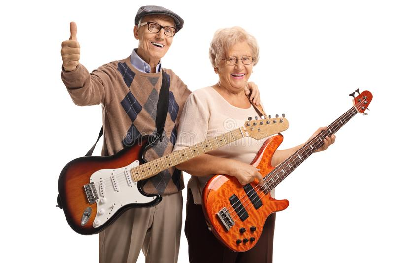 Senior man and woman with electric guitars. Senior men and women with electric guitars isolated on white background royalty free stock images
