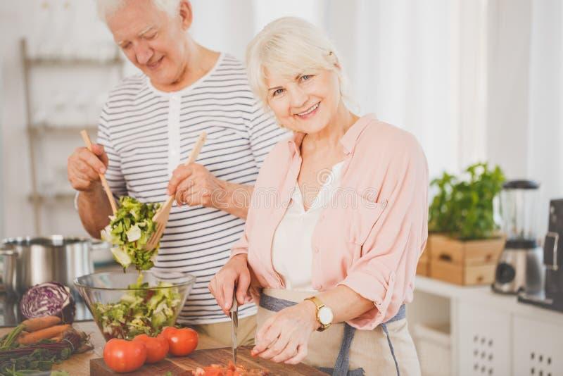 Senior man and woman preparing food royalty free stock photography