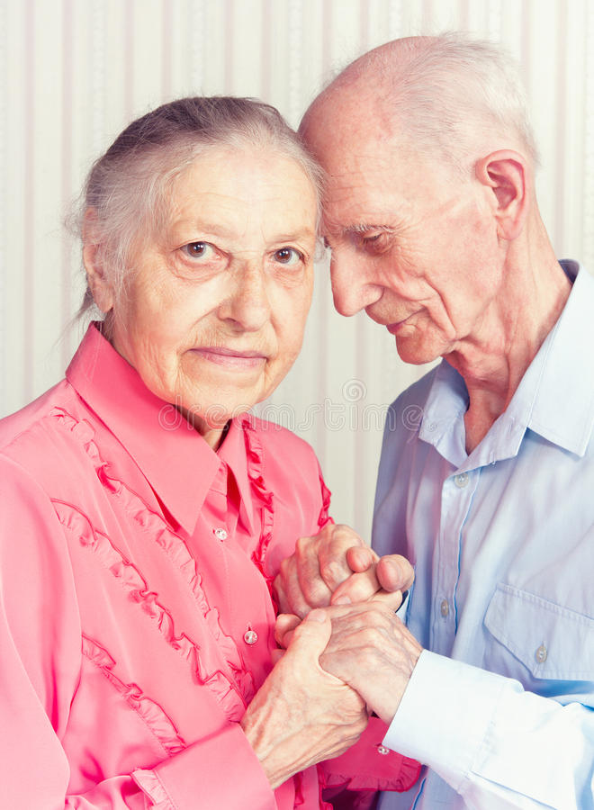 Senior man, woman with their at home. royalty free stock images