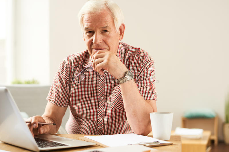 Senior Man Working From Home stock image