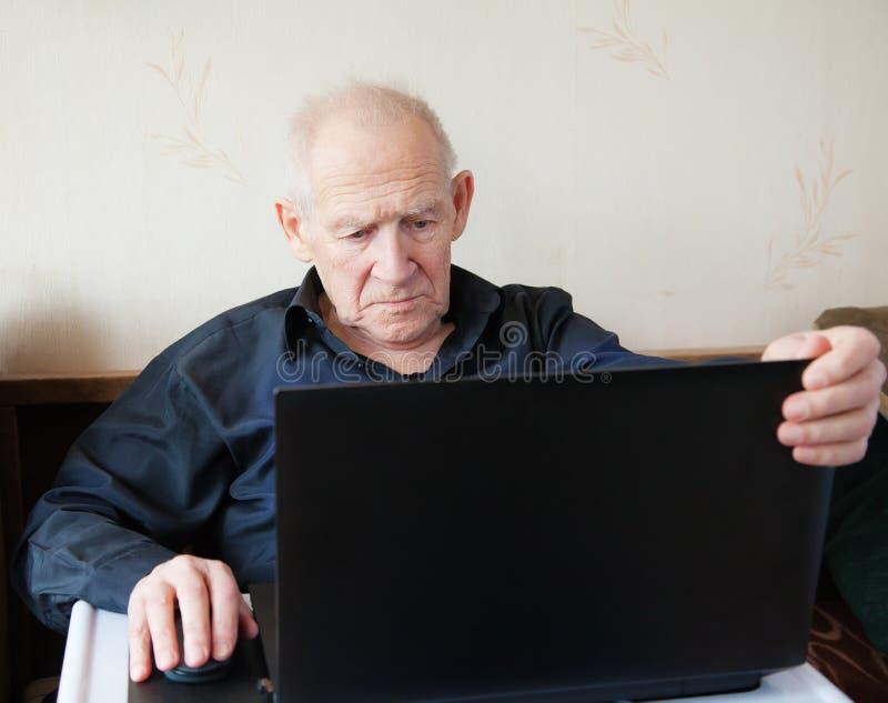 Senior Man Working On A Laptop Royalty Free Stock Image