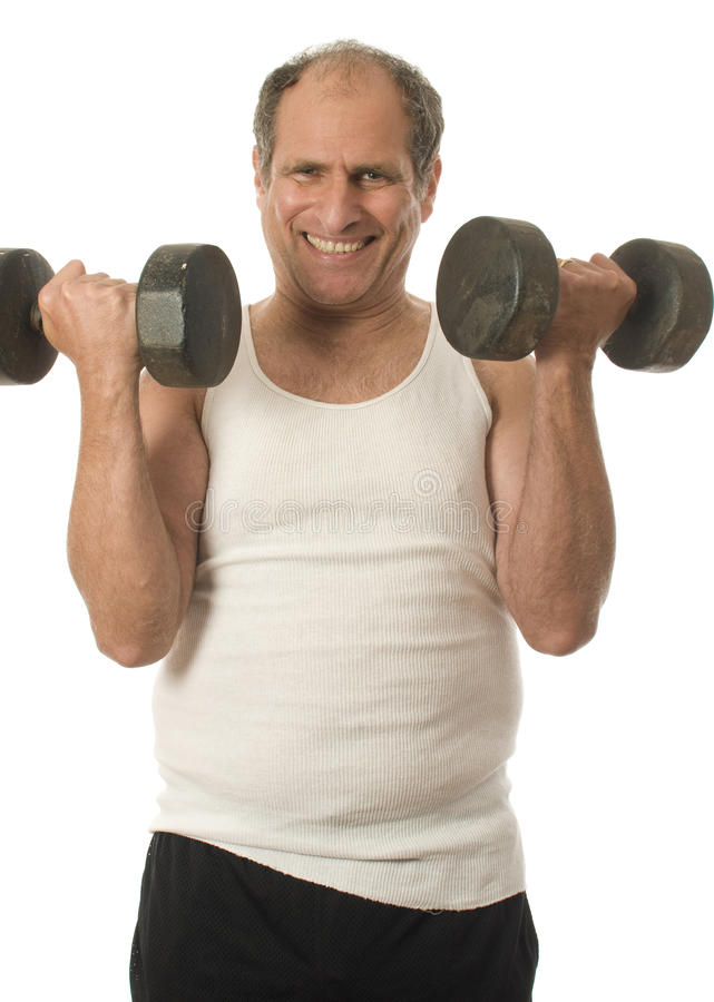 Senior man working out dumbbell weights. Middle age senior man working out exercising with dumbbell weights royalty free stock photography