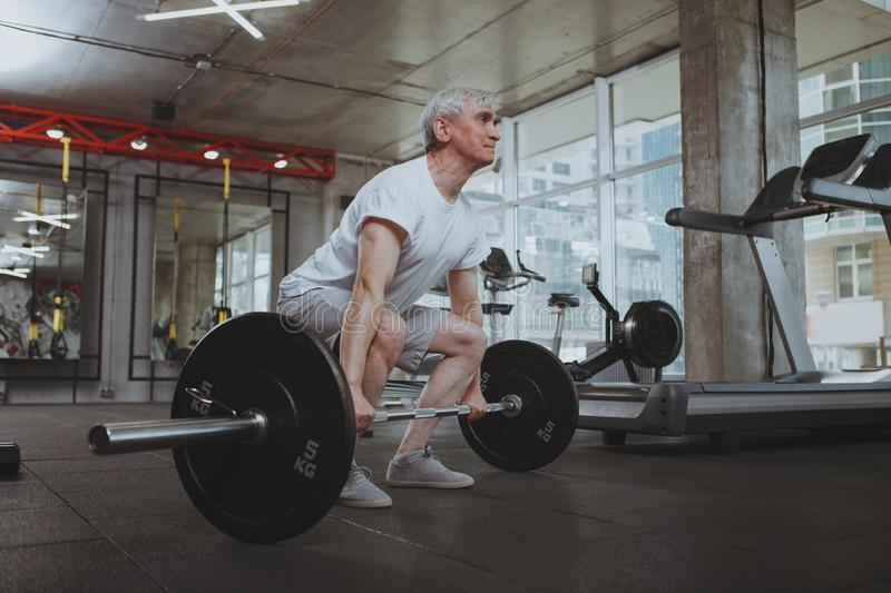 Senior man working out at the gym stock photo