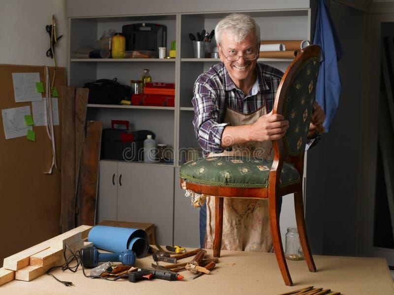 Senior man working stock photo