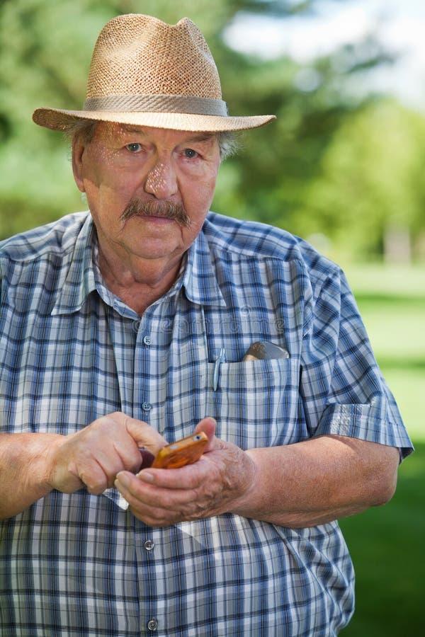 Download Senior Man Writing Text Message Royalty Free Stock Image - Image: 22423896